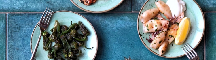 Tapas selection on blue tiled table